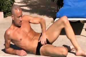 brodie beats off penis around the pool