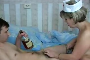 older doctor is engulfing a shlong of her pacient