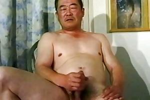old asian lad stroking his penis untill cumming