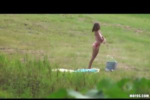 brunette hair teen caught outdoors oiling tits