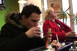 young chap picks up huge grandma in cafe