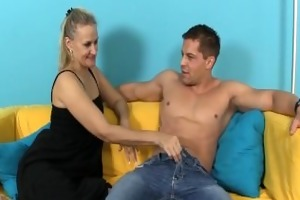 sexually excited milf strokes a penis