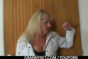 golden-haired grandma in dark stockings fucks