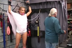 cute young dark bdsm chick receives restrained in
