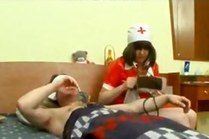 granny nurse tends to young patient. mature