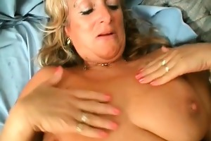 she is is receiving and swallowing young cock