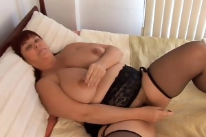 nice-looking busty milf in nylons