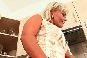 golden-haired soccer mamma with curvy body