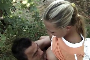 a blond cutie receives fucked outdoors