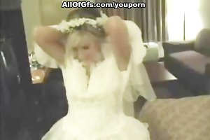 gal in wedding dress sucks a cock and disrobes