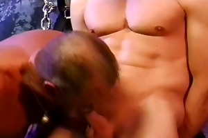 cbt blond muscle man is restrained and suspended