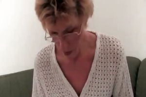 excited old golden-haired woman receives naked on