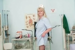 aged blonde lady shows off natural milk cans and
